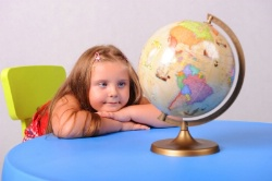 photo of girl with globe