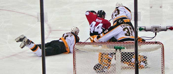 Ottawa Senators vs. Boston Bruins, NHL 2006/07 with w:Tim Thomas in goal—photo by Michelle Tribe
