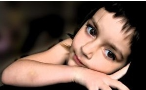 young child with dark hair and large eyes