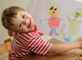 Young Boy with Down Syndrome showing artwork