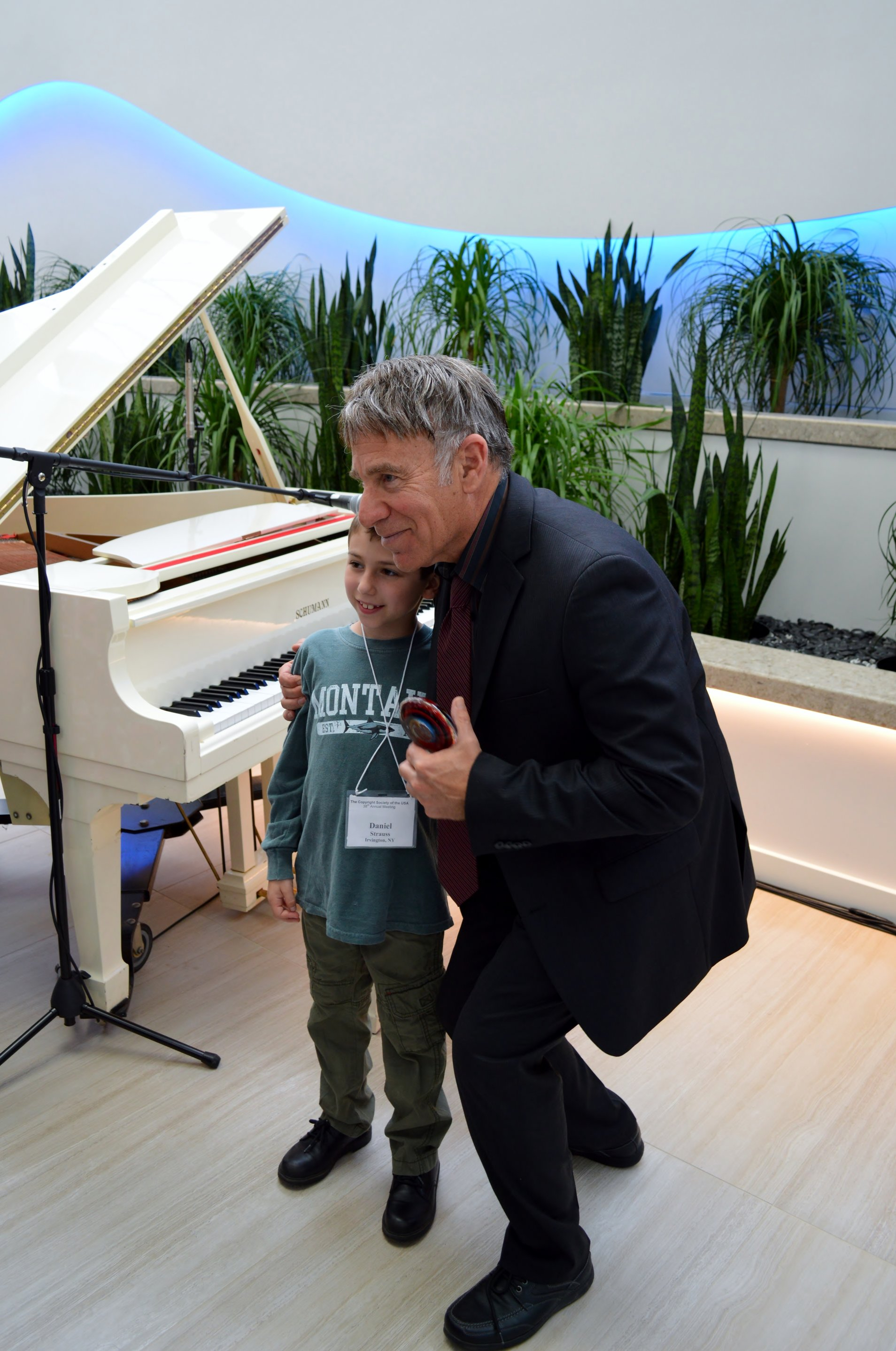 Stephen Schwartz poses for a photo with a young fan