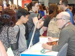Lowell H. Press signed copies of his Benjamin Franklin Award winning book, THE KINGDOM OF THE SUN AND MOON, in IBPA's Cooperative Booth.