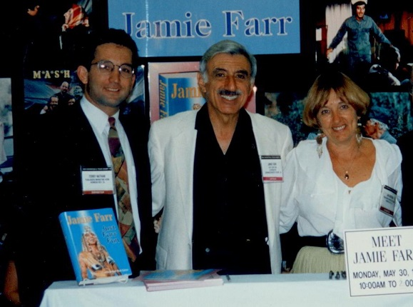 From left to right: Terry Nathan, Jamie Farr, Jan Nathan.; IBPA's cooperative booth (1994).