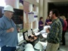Paul talking to a Symposium Attendee at the Heartland LIG Booth