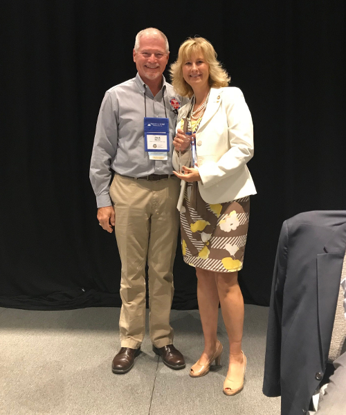 Norm Menser Award presented to Pam Kirchem in 2018
