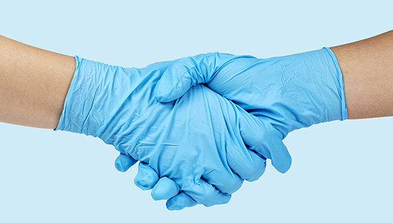 handshake with doctor's gloves