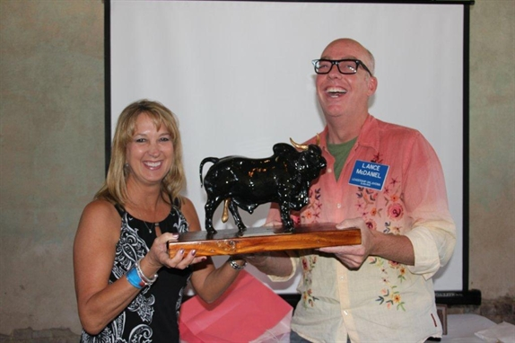 Chair Michele Campbell presents Golden Bull Award to Lance McDaniel