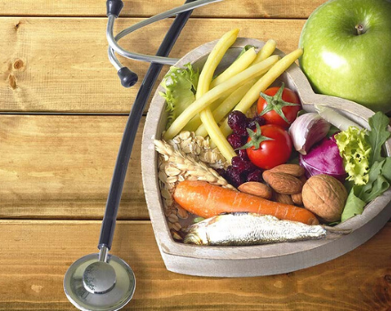 heart bowl filled with healthy produce next to a stethoscope