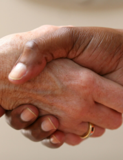/Close up of naturopathic doctor shaking hand of new patient