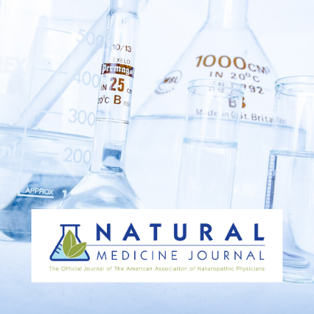 Science beakers displayed in background of Natural Medicine Journal Logo