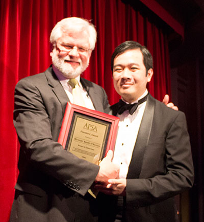 Photo of M. Kerry O'Banion and Freddy Nguyen at the Founders Award ceremony