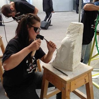 Using sculpting manual tools at MARMOMACC.