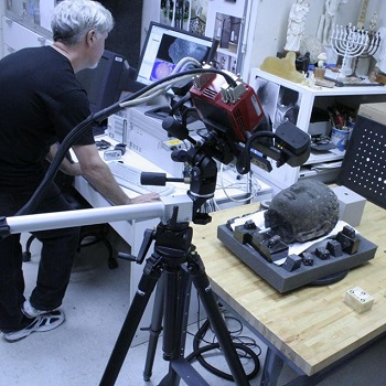 David W. Bassett working on 3D services.
