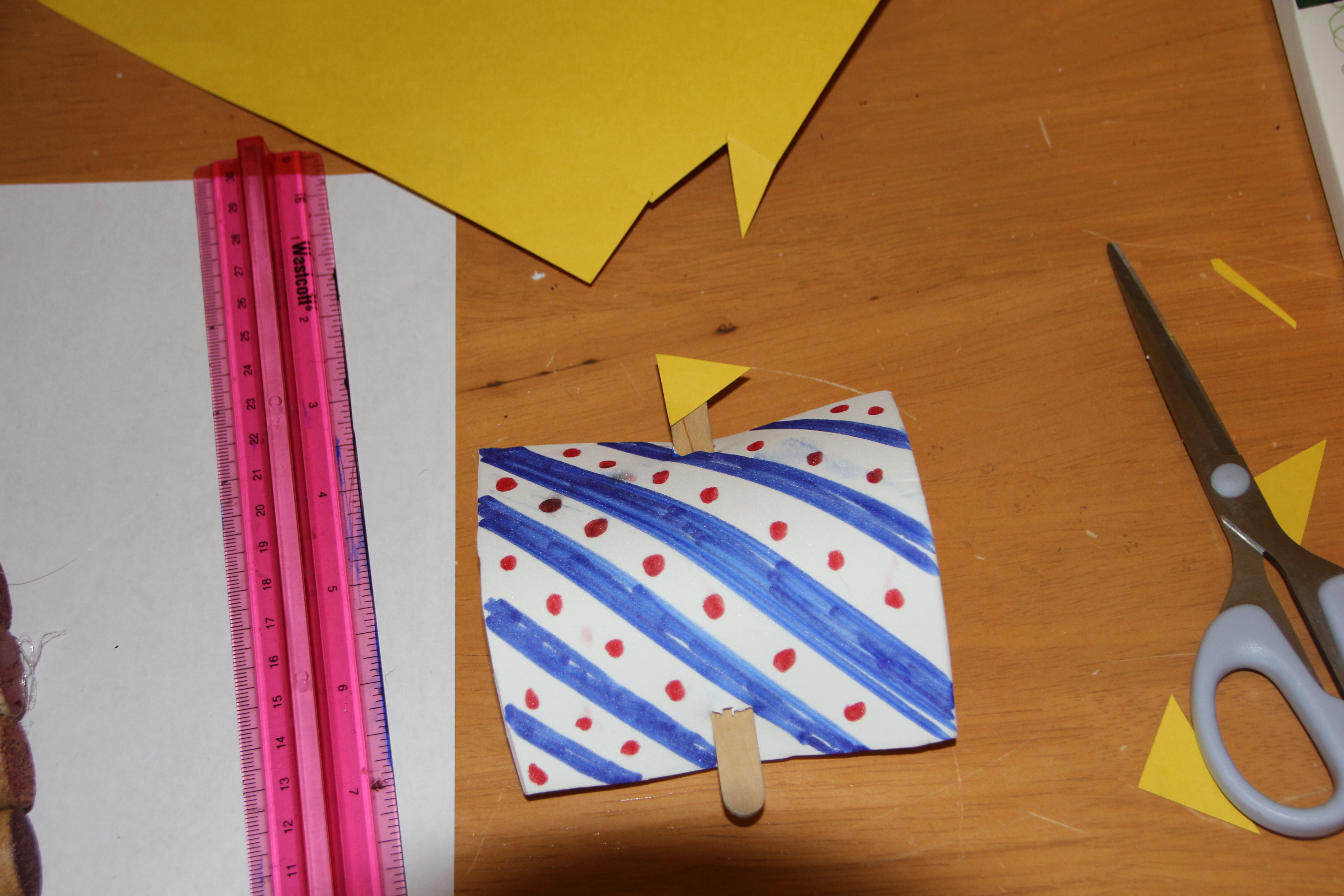 Decorate foam sheet and put on stick