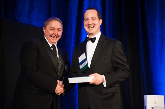 Jeremy S. Williams accepts Emerson G. Spies Award from YLD Chair Steven P. Gould