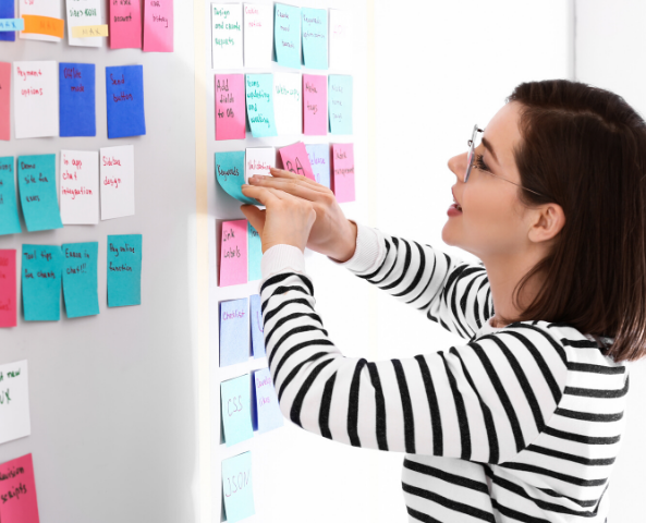 A person using an agile task board.