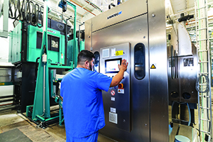 Tunnel operator Rafael Reyna uses the enhanced controls package to program a cycle.
