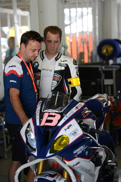 Magny-Cours (FRA) 4 October 2015 - Superstock 1000 Cup. Team BMW ASPI Rider Matthieu Lussiana (FRA) with BMW Motorrad Motorsport expert in pit lane before the start - BMW S 1000 RR #94.