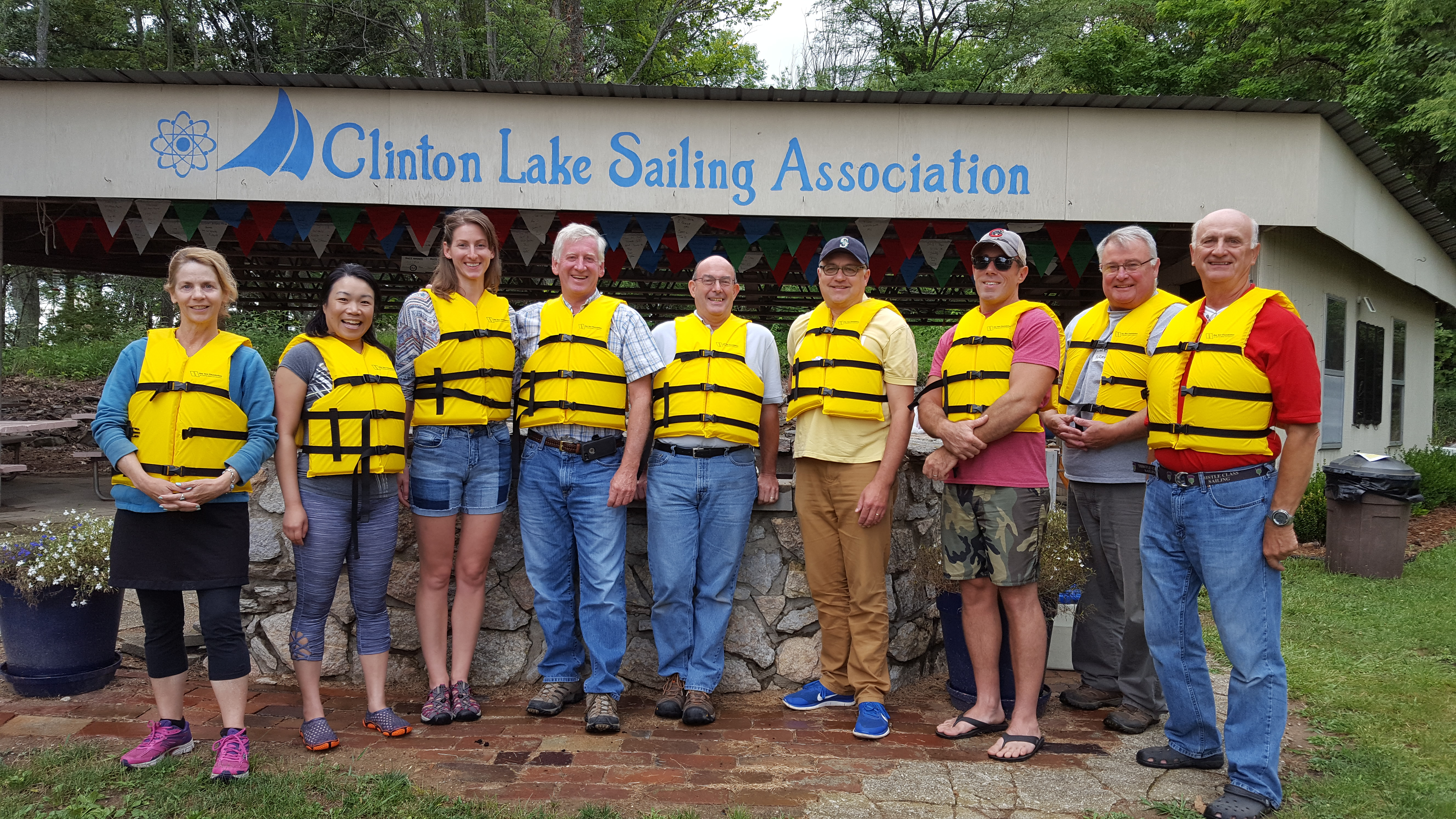 Group of people wearing life jackets at a sailing association