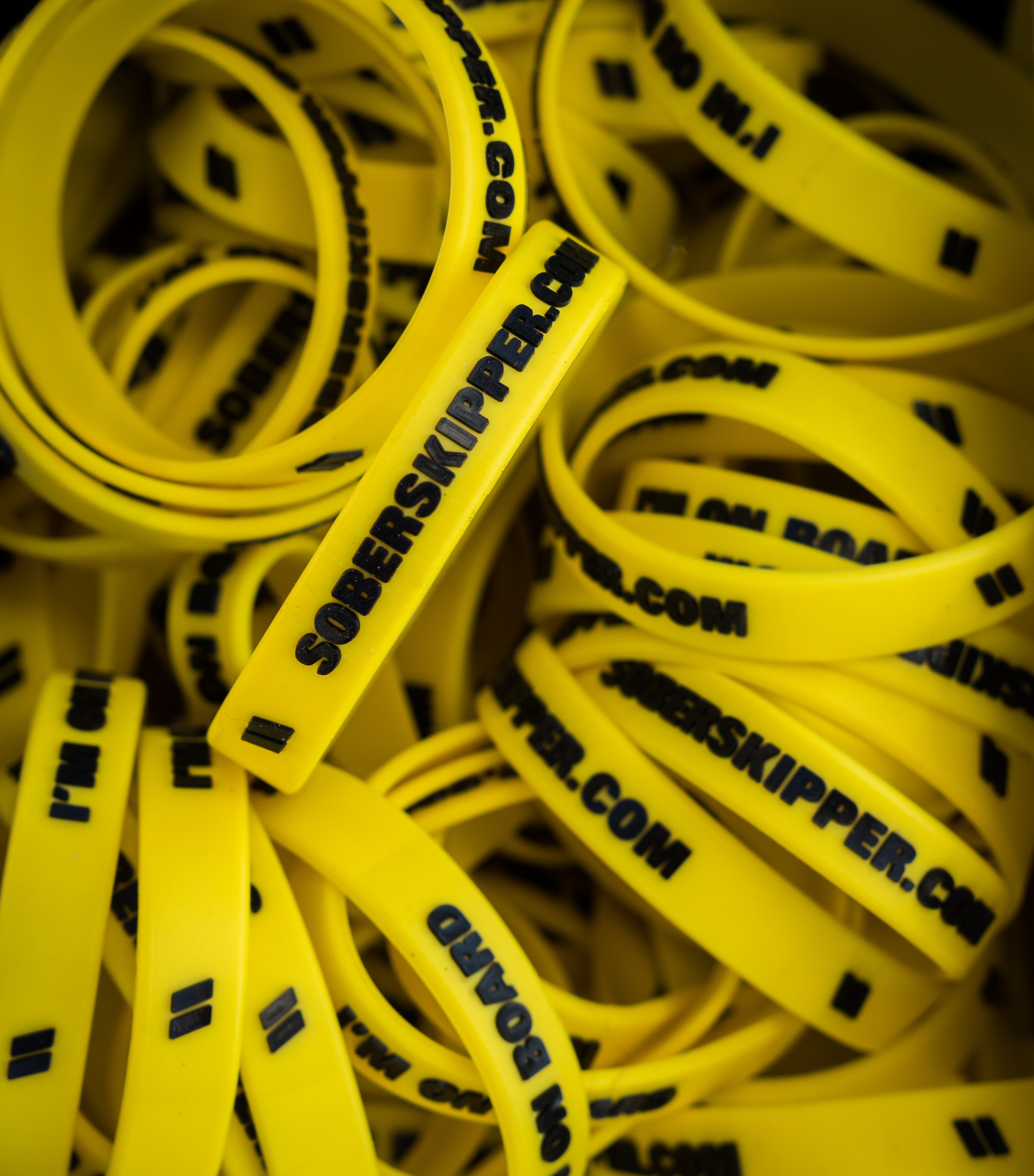 Photo of hundreds of Sober Skipper yellow wristbands