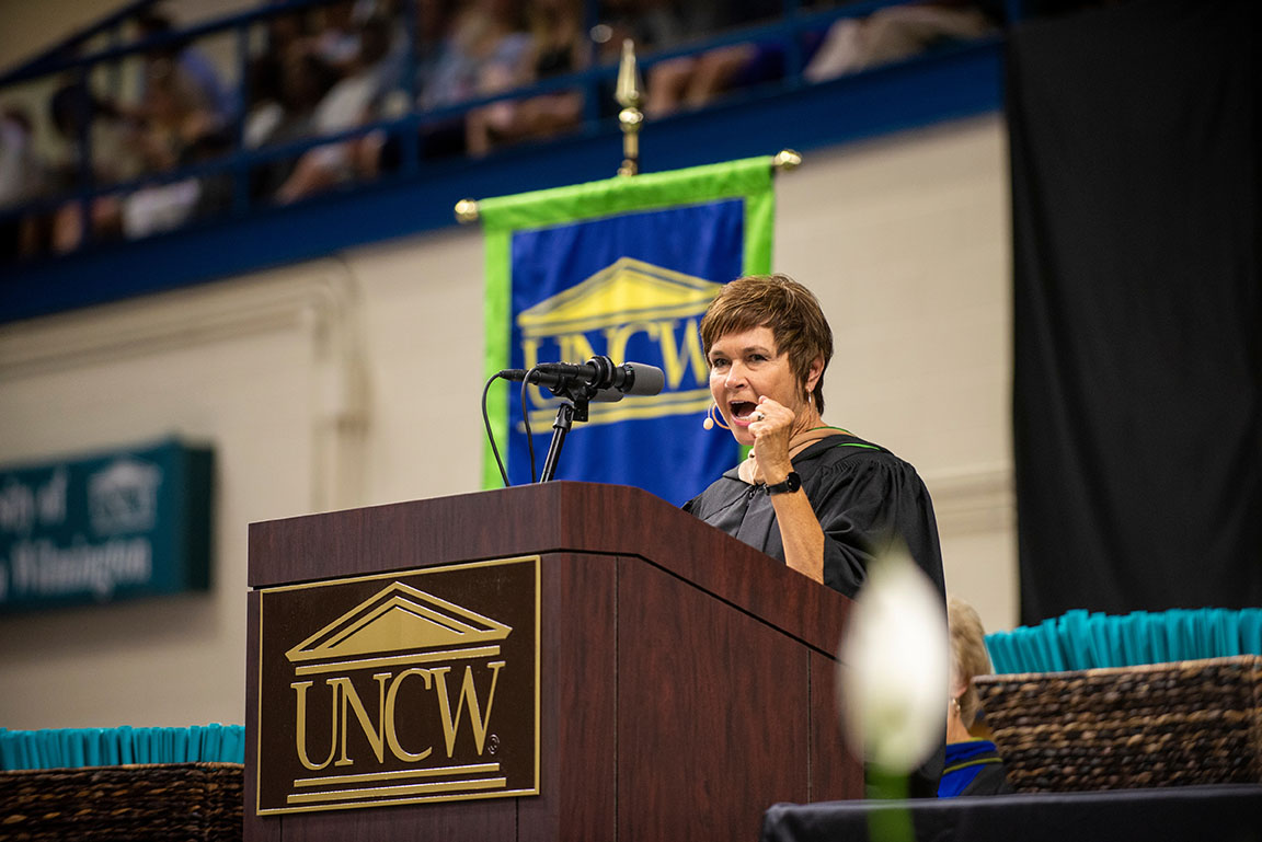 Tharp giving the commencement speech at UNCW Cameron School of Business