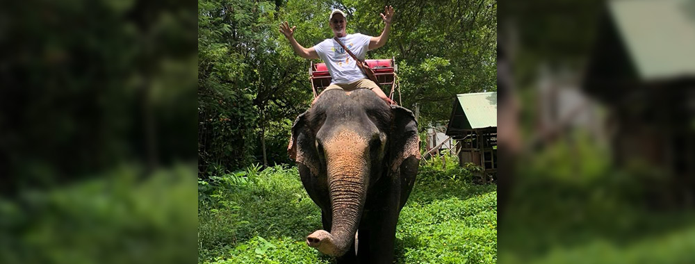 Troy on elephant ride in Thailand