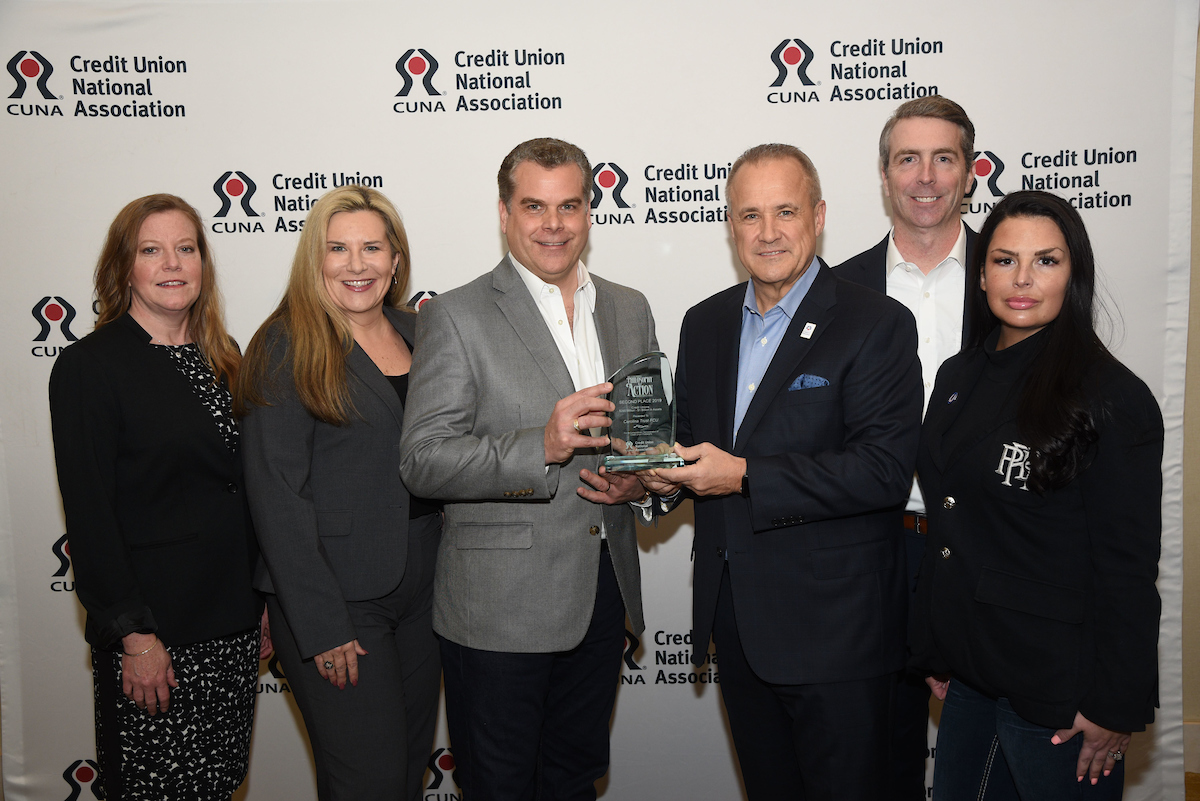 Carolina Trust staff accepting 2019 CUNA Award