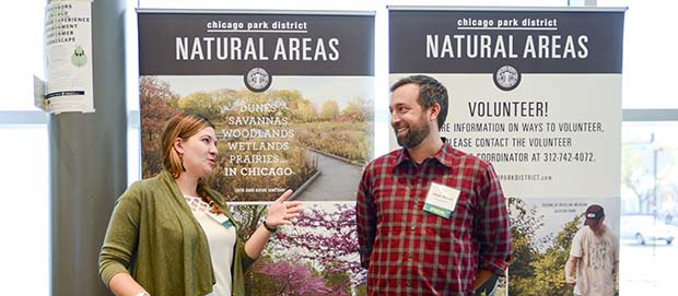 Natural areas staff talking with volunteers at Chicago Wilderness conference