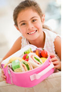 Girl with lunchbox photo