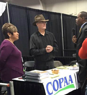 picture of Debra and David Beinke at COPAA Booth being interviewed by the local news