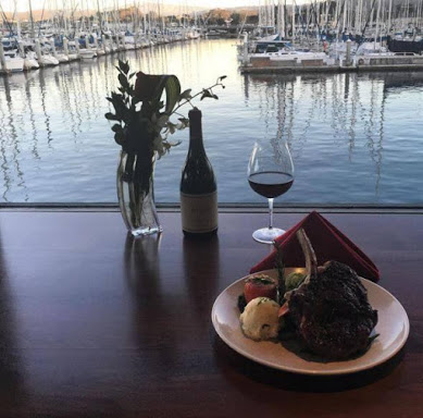 Picture of wine and food overlooking harbor