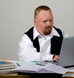 Man with Down Syndrome at computer working