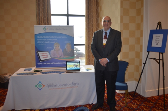 picture of man in front of exhibit table for YourSpecialEducationRights