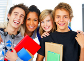 Group of Four Teenagers holding books