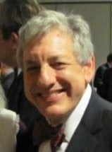 picture of Andrew Feinstein, man with grey hair and wearing suit, smiling