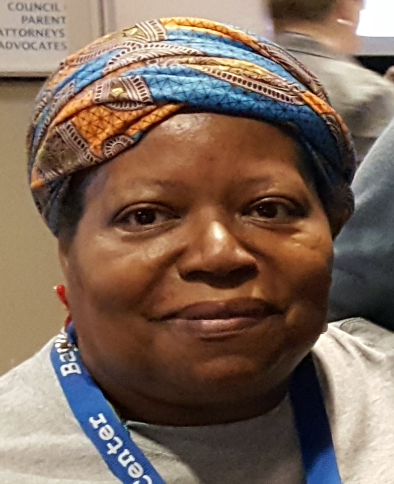 black woman with multicolored turbin on head