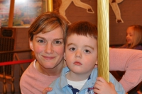 mom and boy on carousel