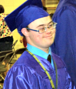 Young adult with down syndrome graduating