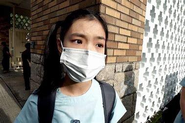 young asian girl wearing mask