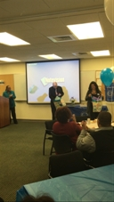 Chapter Faculty Advisors Dr. Gary Koch and Dr. RoseMary Cairo opening thank you gifts for their support and guidance