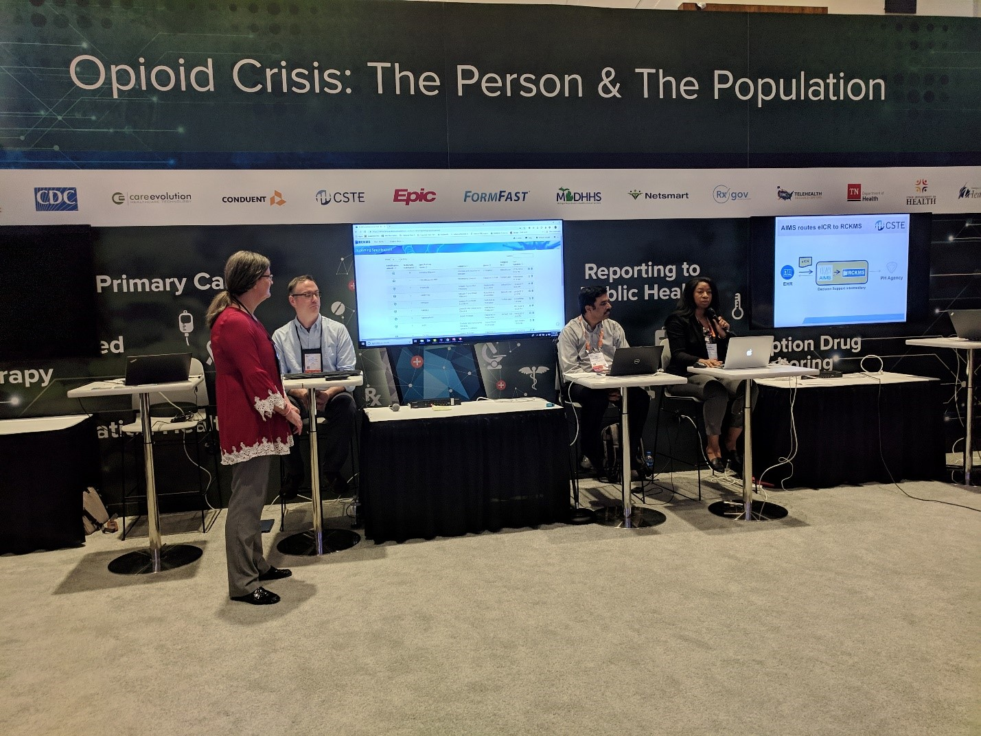 Pictured: Partners demonstrating The Opioid Crisis: The Person and The Population use case at the 2019 HIMSS Global Conference's Interoperability Showcase. From left to right, Laura Conn (CDC), Jim Fitzpatrick (Epic), Sai Valluripalli (APHL) and Charisse LaVell (CSTE).