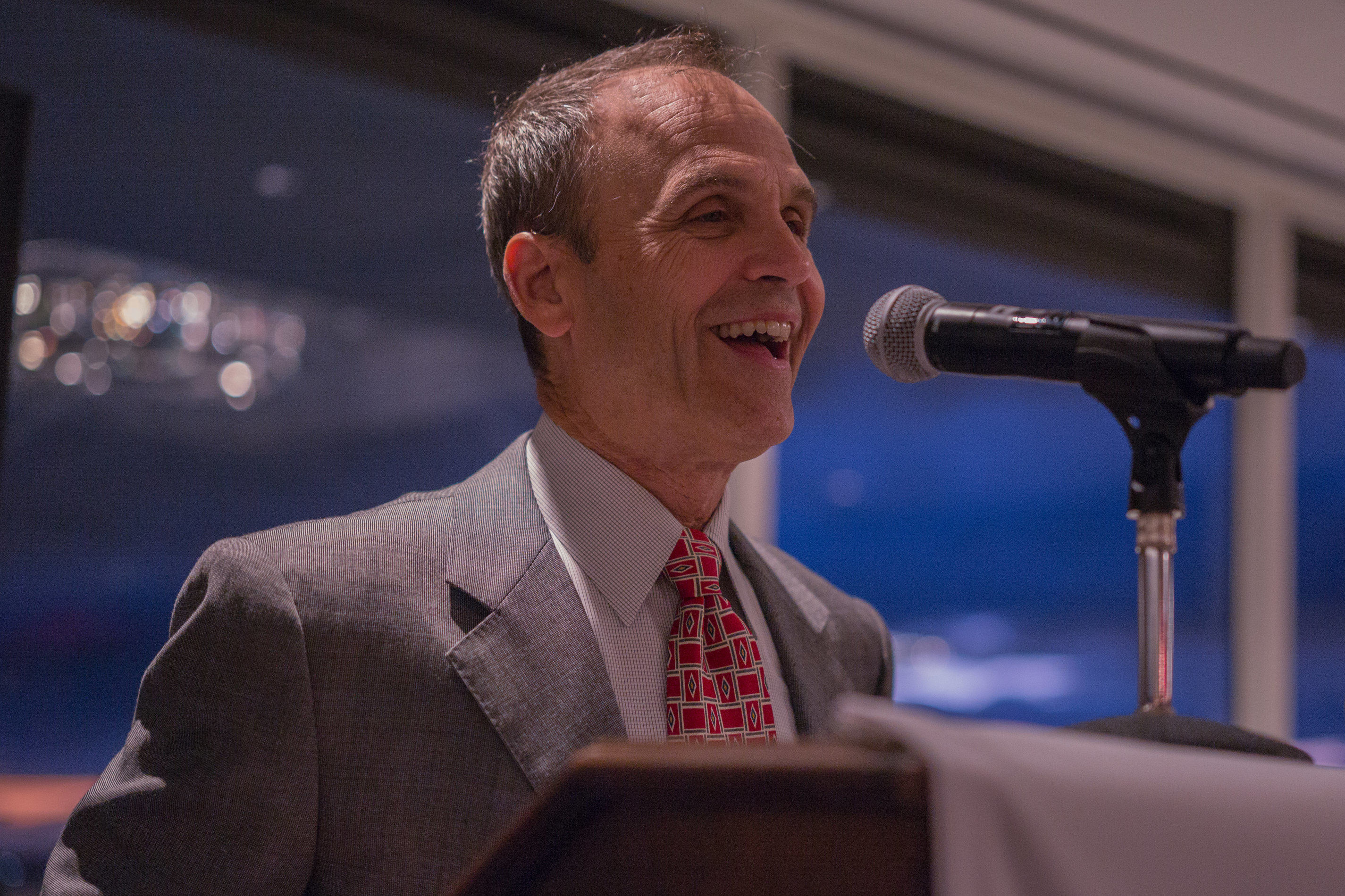 Scott Turow at podium. Photo by Alan Behr.