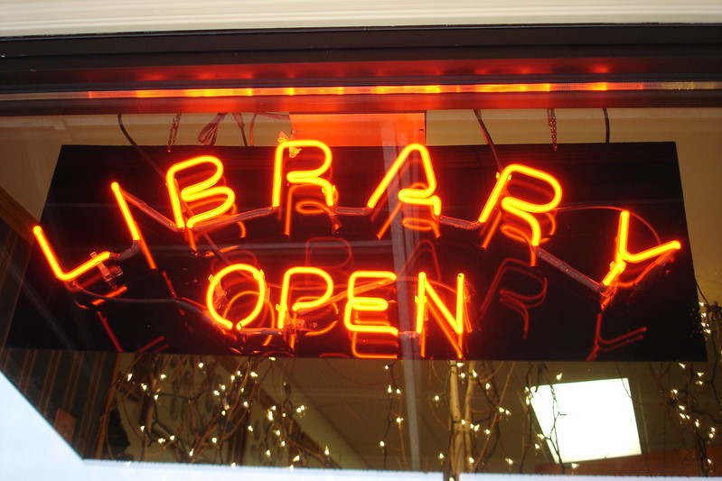 library open neon sign