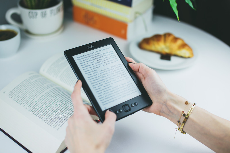person holding Kindle