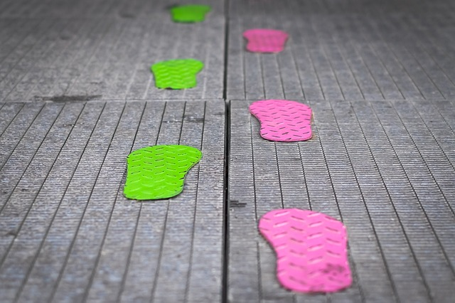 colorful metal footprints moving forward