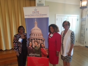 Posing in front of EWTG banner at luncheon in August with Geraldine Tucker