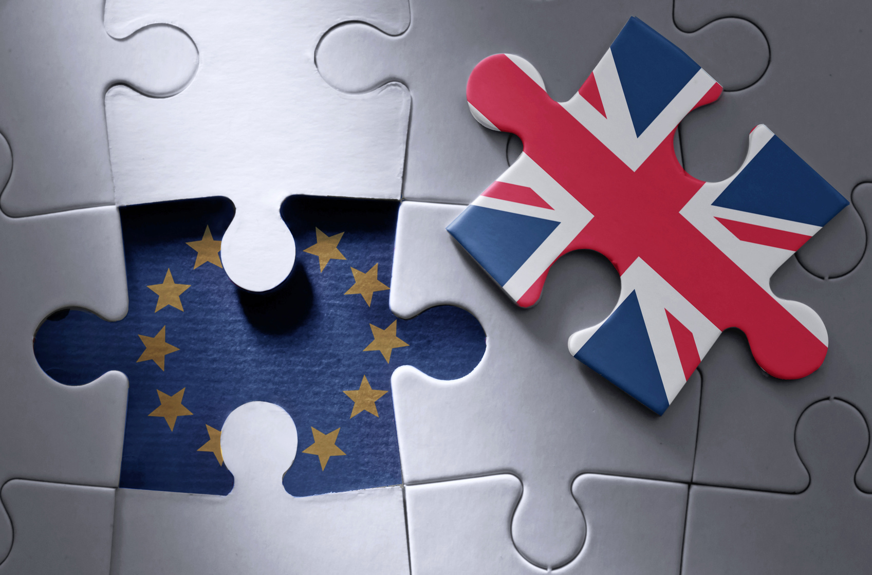 image of jigsaw puzzle wih EU flag and Union Jack flag pieces