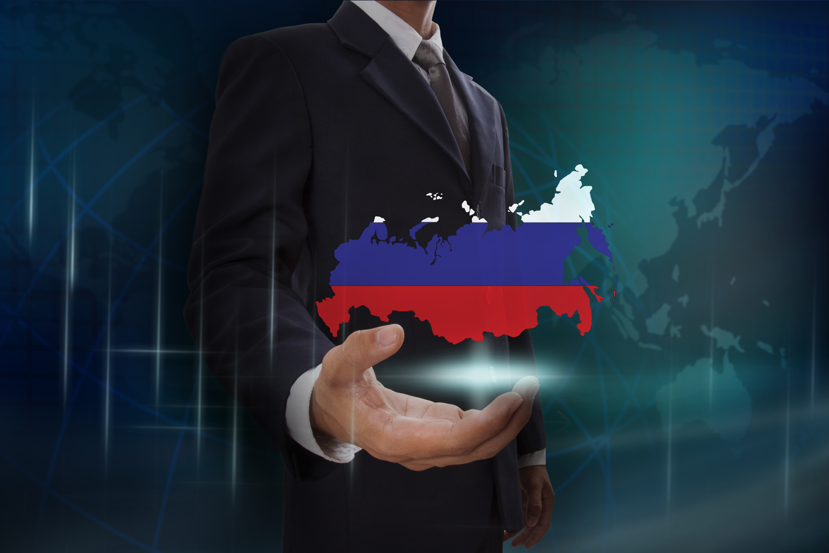 Businessman showing map of Russia on globe background