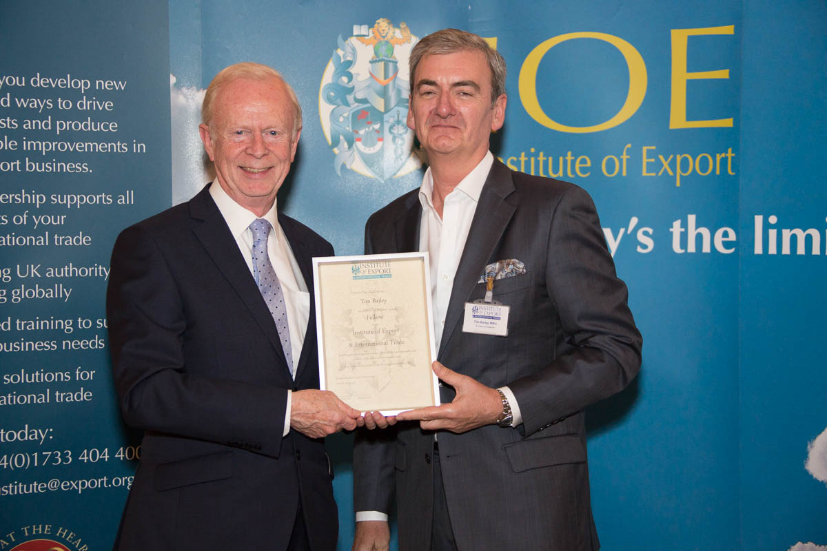 Tim Bailey given his award by Lord Empey OBE