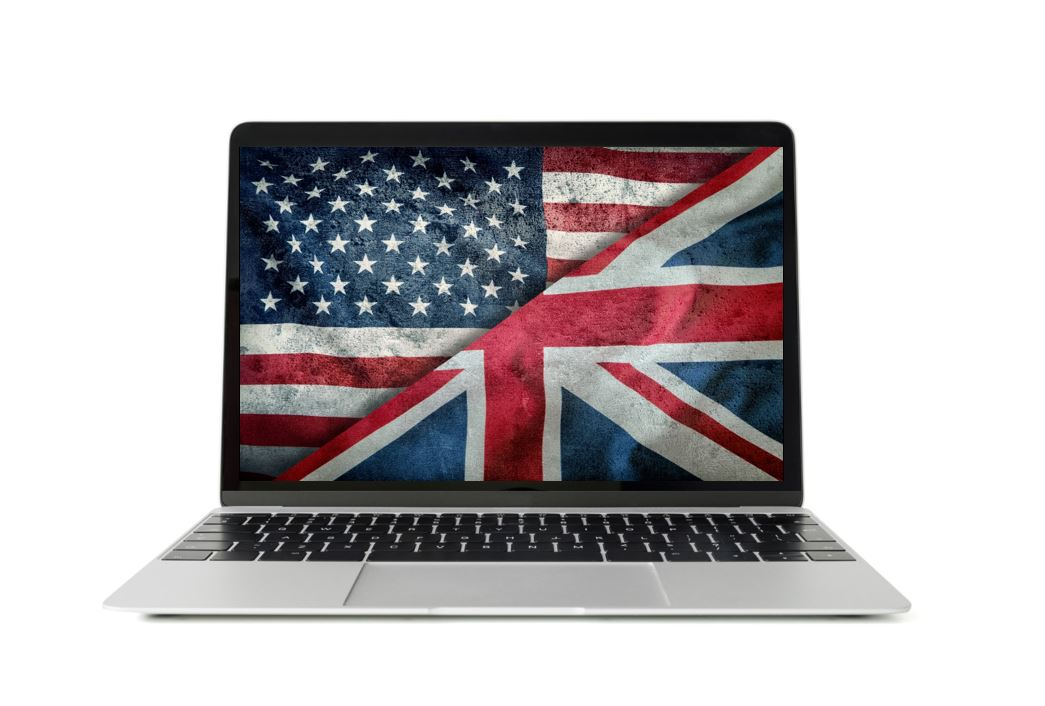 laptop screen with Untion Jack and USA flags